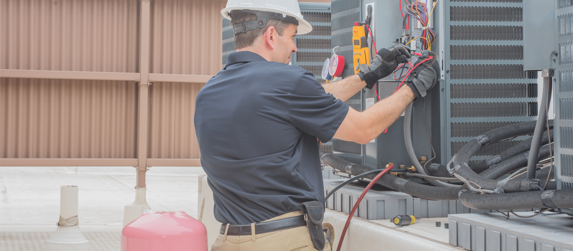 a specialist making a commercial hvac repair